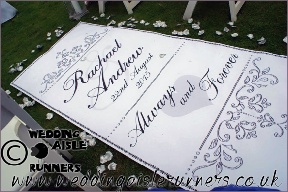 ourtdoor wedding ceremony with silver and black aisle runner